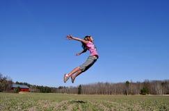 Ragazza di salto Fotografia Stock