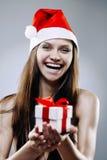 Ragazza di Santa con il contenitore di regalo Fotografia Stock