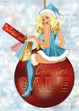 Ragazza di Santa di vendita di Natale con le borse del negozio Fotografia Stock Libera da Diritti