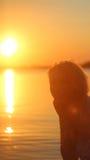 Ragazza di tramonto Immagine Stock