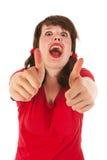 Ragazza divertente con i pollici in su fotografia stock