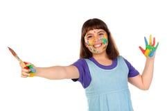 Ragazza divertente con le sue mani sporche di pittura immagini stock