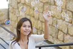 Ragazza e bolle Fotografie Stock