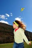 Ragazza e cervo volante Fotografie Stock Libere da Diritti