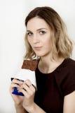 Ragazza e cioccolato Fotografie Stock