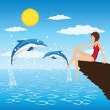 Ragazza e delfini. Fotografie Stock