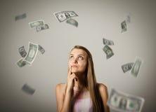 Ragazza e dollari Immagine Stock