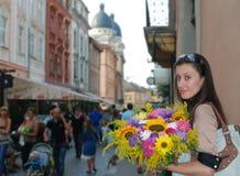 Ragazza e fiori Fotografia Stock Libera da Diritti