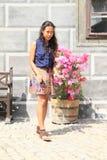 Ragazza e fiori Fotografie Stock