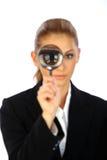 Ragazza e lente d'ingrandimento di affari Fotografie Stock Libere da Diritti