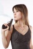 Ragazza e pistola Fotografia Stock