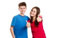 Ragazza e ragazzo che mostrano segno giusto Fotografia Stock