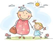 Ragazza e sua nonna su una passeggiata Fotografia Stock Libera da Diritti