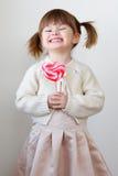 Ragazza e un lollipop Fotografia Stock