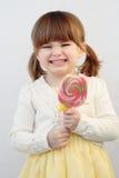 Ragazza e un lollipop Fotografie Stock