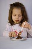 Ragazza ed il cioccolato Immagine Stock