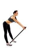 Ragazza esile che fa ginnastica isolata su bianco Fotografia Stock