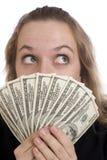 Ragazza espressiva con le fatture del dollaro fotografia stock
