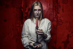 Ragazza fantasma con la candela Fotografia Stock