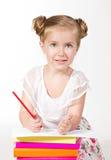 Ragazza favorita con la matita rossa che esamina macchina fotografica Fotografia Stock Libera da Diritti