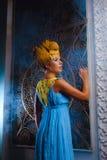 Ragazza favorita in un vestito blu Fotografie Stock Libere da Diritti