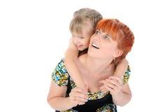 Ragazza felice che abbraccia la sua madre Fotografie Stock