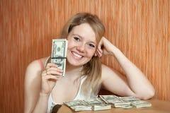 Ragazza felice con i dollari US Nella casa Fotografia Stock