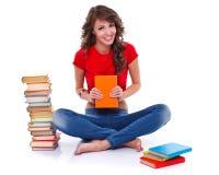 Ragazza felice con i libri Fotografia Stock