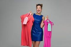 Ragazza felice con i vestiti Fotografie Stock