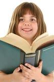 Ragazza felice con il grande libro fotografie stock libere da diritti