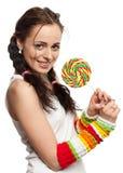 Ragazza felice con il lollipop. Immagini Stock