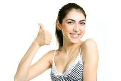 Ragazza felice con il suo pollice in su Immagine Stock