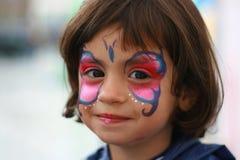 Ragazza felice con uno sface verniciato Fotografia Stock