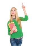 Ragazza felice dello studente che indica su sullo spazio della copia Immagini Stock Libere da Diritti