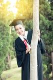 Ragazza felice dello studente graduato, congratulazioni Fotografia Stock