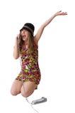 Ragazza felice di bellezza che comunica dal telefono Fotografie Stock