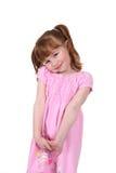 Ragazza felice e sveglia nel colore rosa Fotografie Stock Libere da Diritti