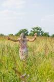Ragazza felice nel campo Fotografia Stock Libera da Diritti