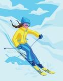 Ragazza felice sulla località di soggiorno di inverno che scia là Immagine Stock
