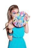 Ragazza felice sveglia con la gamma di colori colorata e le spazzole Fotografia Stock Libera da Diritti