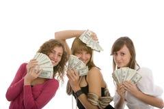 Ragazza felice tre con i dollari a disposizione Fotografia Stock