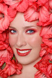 Ragazza in fiori immagine stock