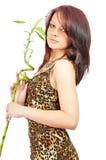 Ragazza fresca piacevole con bambù in mani immagine stock libera da diritti