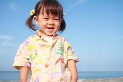 Ragazza giapponese che fa una pausa la spiaggia Immagine Stock Libera da Diritti