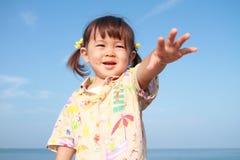Ragazza giapponese che fa una pausa la spiaggia Fotografie Stock