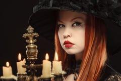 Ragazza gotica con le candele Fotografia Stock Libera da Diritti