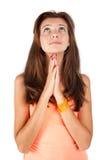 Ragazza graziosa che prega e che guarda verso l'alto Immagine Stock Libera da Diritti