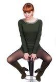 Ragazza graziosa che si siede su una sedia Immagine Stock Libera da Diritti