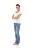 Ragazza graziosa che sta a piedi nudi sorridente Immagine Stock