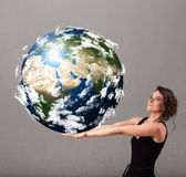 Ragazza graziosa che tiene la terra del pianeta 3d Fotografie Stock